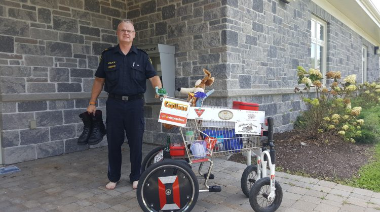 Photo Credit: Drew Hosick - North Grenville Youth Up! member Craig McCormick with business advertising shopping cart